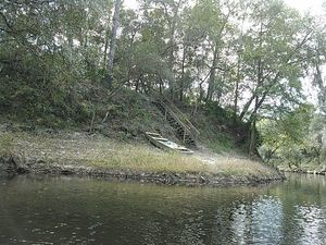 A boat at a bend in the river 30.5337410, -83.2490692
