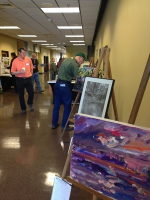 David Bosch and Bret Wagenhorst inspect artworks