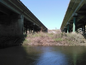 USGS gage, between US 41 bridges on west bank 30.8926620, -83.3188476