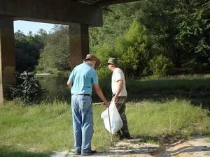 John S. Quarterman and Chris Mericle under the GA 168 bridge