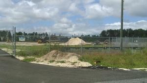 Construction equipment in front of Duke Suwannee Plant, 30.3673830, -83.1780200