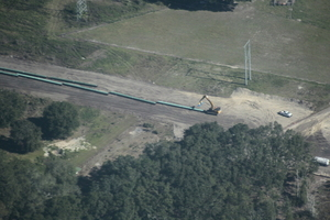 Setting blue pipe in front of 9087 Rocky Sink Rd, Live Oak, FL 32060 @ 92nd Terrace, 30.2825450, -83.0998730
