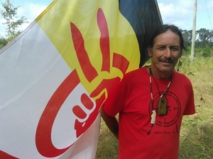 Gregory Payne with AIM flag
