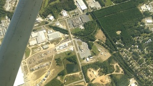 Contractor Yard CY3-6 full of equipment, E down County Farm Road NE to Industrial Blvd., 31.1836510, -83.7523580
