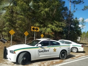 Suwannee County Sheriff cars at closed SRSP gate, 30.3783555, -83.1655342