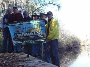 Boaters with WWALS banner by Gretchen Quarterman 30.8315190, -82.3333150