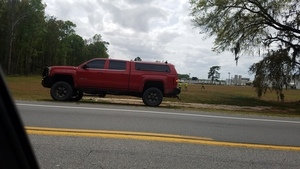 Unlabeled red truck, presumably Price Gregory or Sabal Trail 30.3726492, -83.1553016