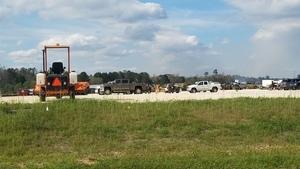 Still more equipment and trucks, 30.7605747, -83.5529692