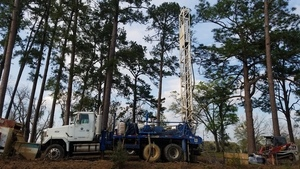 Looks like vertical water well drilling equipment, 30.7485032, -83.4017858