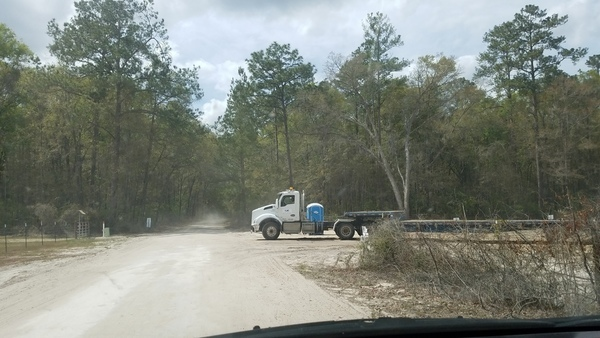 Price Gregory truck exiting Suwannee River HDD site onto 24th Street,