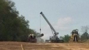 Movie: Set pipe on ground instead of on Troy truck (370M), 30.7483943, -83.4018203