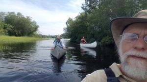 Canoes behind 31.1686111, -83.5452778
