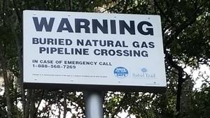 Closeup pipeline sign, 30.4077778, -83.1561111