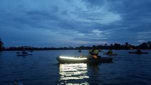 Paddling Banks Lake with lights at dusk 31.0344000, -83.0976938