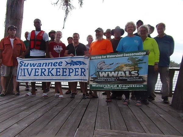 Paddlers with WWALS and Suwannee Riverkeeper Banners,