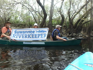 Suwannee Riverkeeper banner on the Alapaha River 30.9295817, -83.0360183