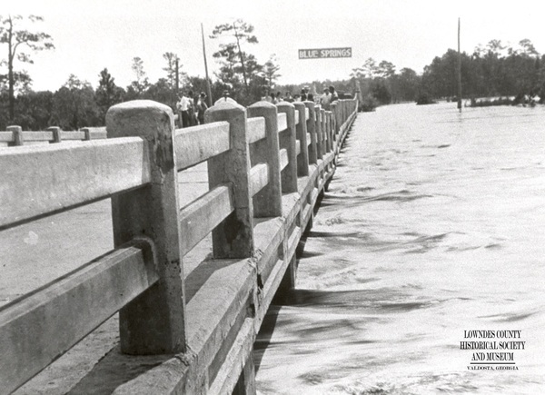 [During flood of-1928 with Blue Springs sign]