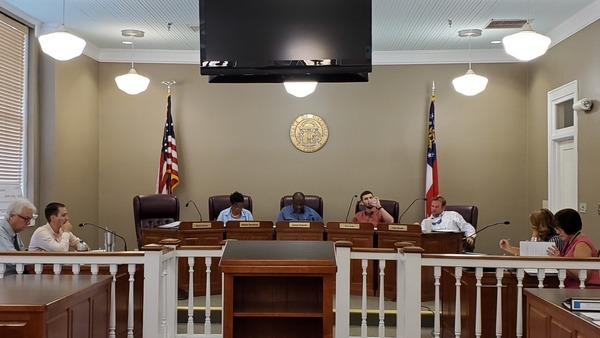 [Attorney?, County Administrator Hampton Raulerson, Absent Jesse Crews (3), Vice Chair Alphya Benefield (1), Chair James E. Everett (2), , Drew Jones (4), Luke Gowen (5), County Clerk Jenifer Nobles, Finance Coordinator Rebecca Harden]