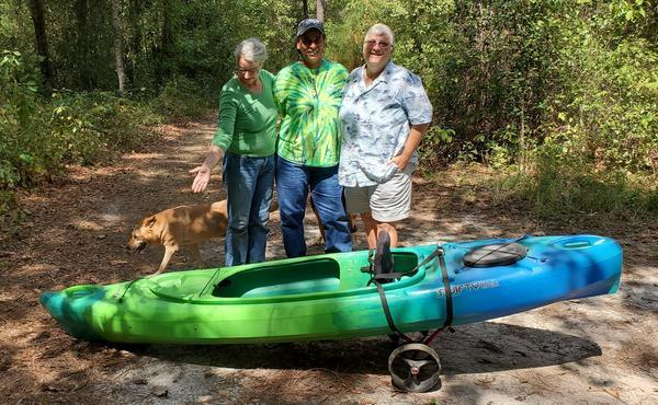 [Raffle kayak with Gretchen, Cindy, Amy, and Yellow and Brown Dog]