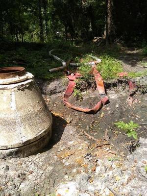 [Manhole with hose]