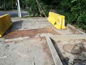 [Manhole at 1406 Sustella Ave., NW of bridge]