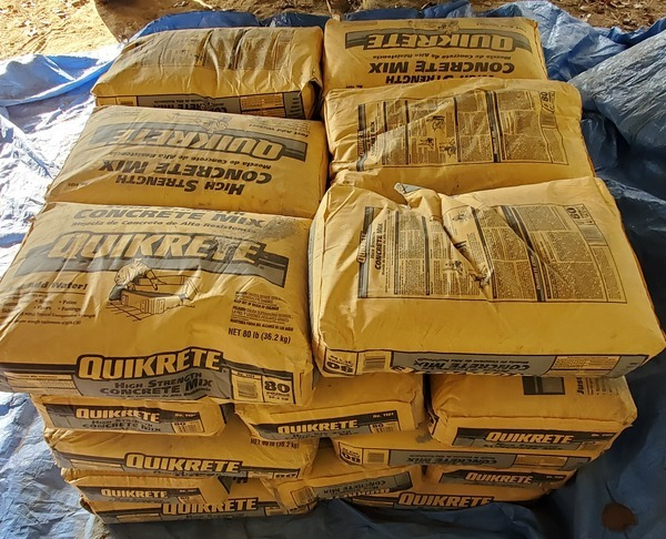 [Thirty 80-pound bags of QuiKrete]
