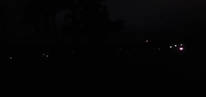 [Cars on GA 122 and amber light at Banks Lake Boat Ramp]