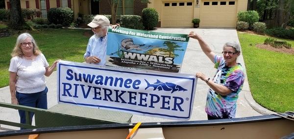 [Canoe donor Sue Raffaele, Suwannee Riverkeeper John S. Quarterman, WWALS E.D. Gretchen Quarterman]