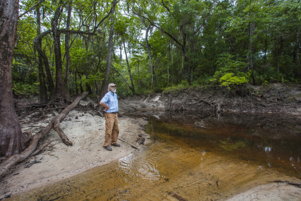 [John Quarterman stands by the Withlacoochee River in Georgia. Matt Odom / for NBC News]