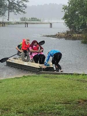 [Fannie Gibbs in a boat in the rain]
