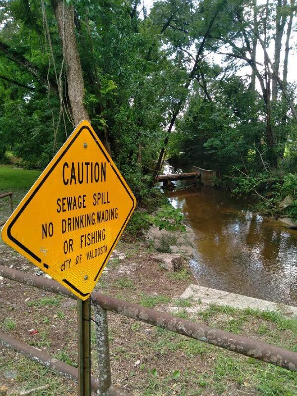 [Caution sign, Wainwright Drive, Onemile Branch, sewer pipe]