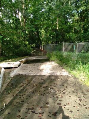[Azalea City Trail and fence]
