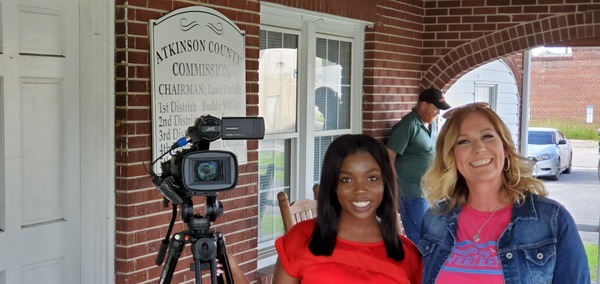 [Fox 31 Reporter Typhani Gray, WWALS water quality tester Valerie Folsom]