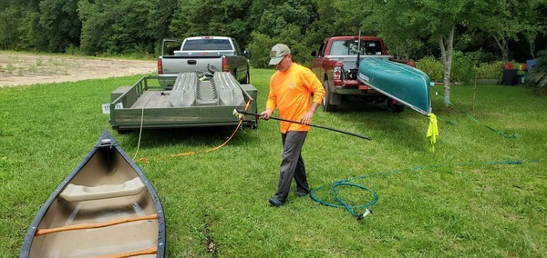 [Russell washing the canoes, 14:57:51, 30.8365549, -83.5225833]
