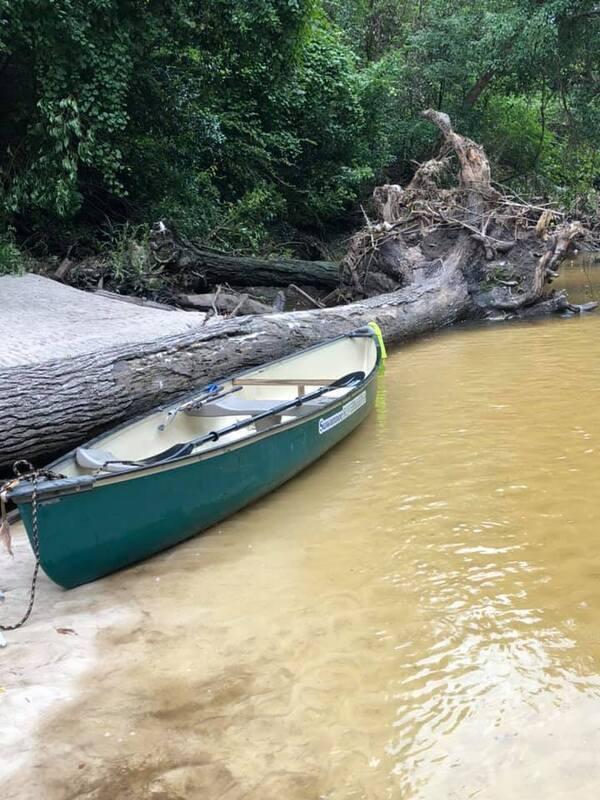 [Suwannee Riverkeeper canoe at NSFRR logjam by Russell McBride]