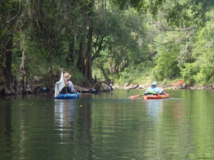 [John S. Quarterman and Julie Bowland paddle downstream, 10:52:01]