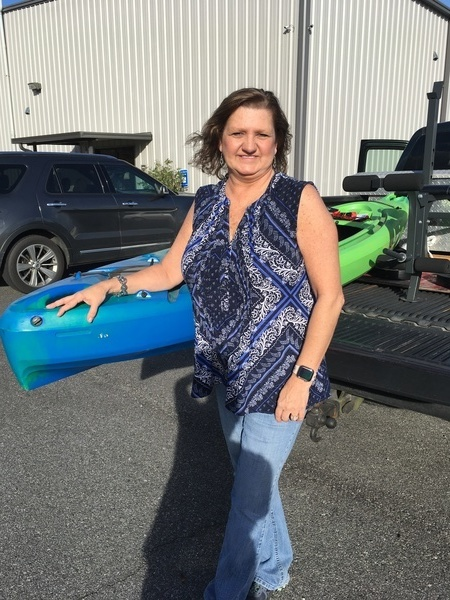 [Rhonda Kelly with the kayak she won in the WWALS raffle]