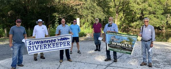[Photo: Gretchen Quarterman, of Chad McLeod (Lowndes County), George Page (VLPRA), Mac McCall (Architect), Jason Scarpate (ASA Engineering), John S. Quarterman (Suwannee Riverkeeper), Tom H. Johnson Jr. (WWALS President), Tom Baird (Archaeologist) at Troupville Boat Ramp]